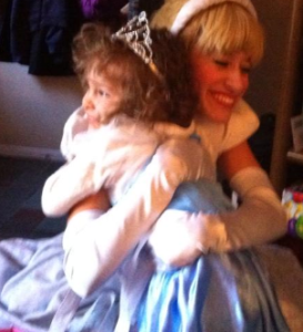 Cinderella gives Hannah a hug during her fourth birthday party.